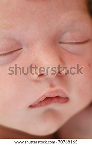 Macro shot of a sleeping baby's face - stock photo