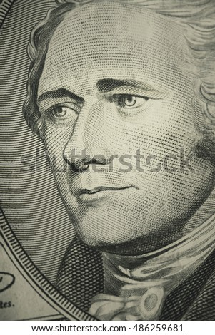 Macro shot of Alexander Hamilton on the U.S. Ten dollar bill.