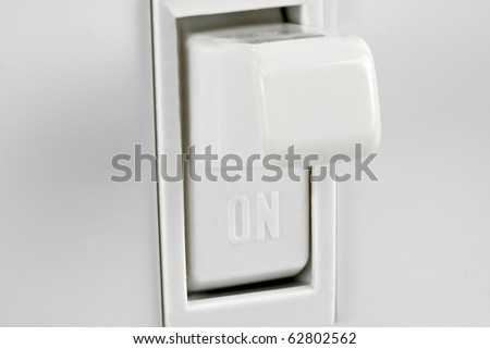 macro shot of american 110 light switch - stock photo