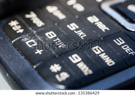macro shot of an obsolete and dirty mobile phone keypad - stock photo