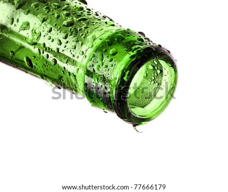 Macro shot of beer bottle with water drops isolated on white - stock photo