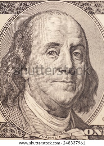 Macro shot of Benjamin Franklin portrait from a $100 bill