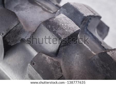 Macro shot of black rubber tire - stock photo