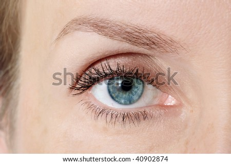 Macro shot of blue woman's eye with clear makeup
