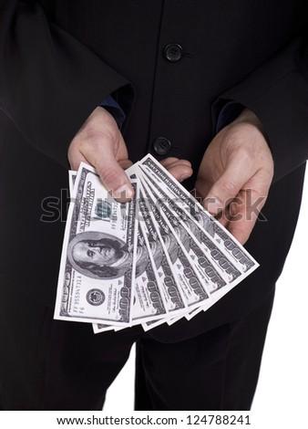 Macro shot of businessman holding fan of 100 US dollar. - stock photo