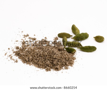 Macro shot of cardamom pods and ground cardamom. One in a current series of 6 multi-form spice macros. - stock photo