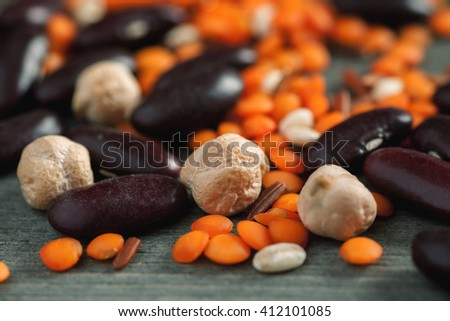 Macro shot of chickpeas, red lentil and red beans, selective focus - stock photo