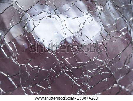 Macro shot of clear cracked glass - stock photo