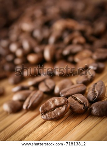 Macro shot of coffee beans with selective focus - stock photo