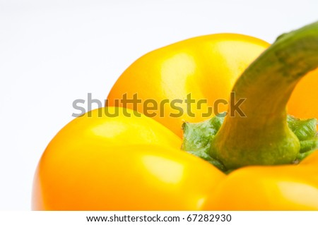 Macro shot of colorful bell peppers isolated on white - stock photo