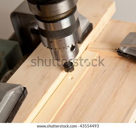 Macro shot of counter sink drill bit in chuck - stock photo