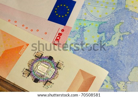 macro shot of euro currency showing the europe map flag and the fifty hologram - stock photo
