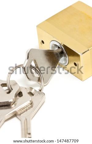 Macro shot of golden padlock and key. - stock photo