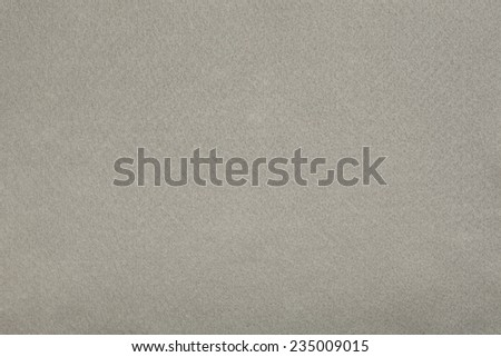 Macro shot of gray felt tissue cloth, closeup texture background with details in structure. - stock photo