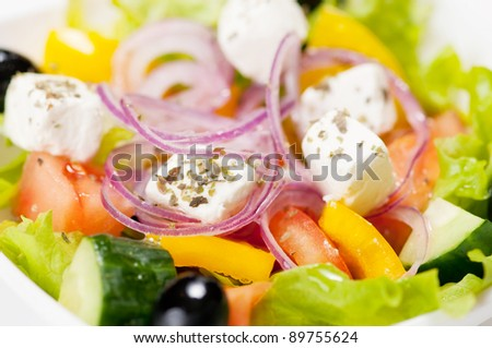 Macro shot of greek salad on the white background - stock photo