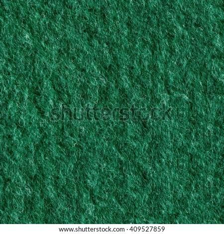 Macro shot of green felt tissue cloth, closeup texture. Seamless square texture. Tile ready. - stock photo