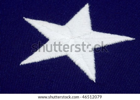 Macro shot of hand stitched star from an american flag - stock photo