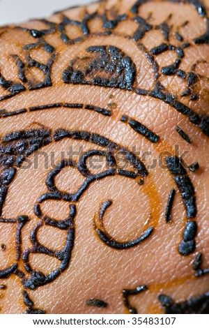 Macro shot of Henna right after it is applied to the skin - stock photo