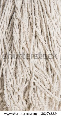 Macro shot of housekeeping object, white floor mop - stock photo