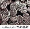 Macro shot of iron nails heads - stock photo