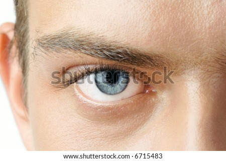 Macro shot of man's blue eye with visible blood vessels - stock photo