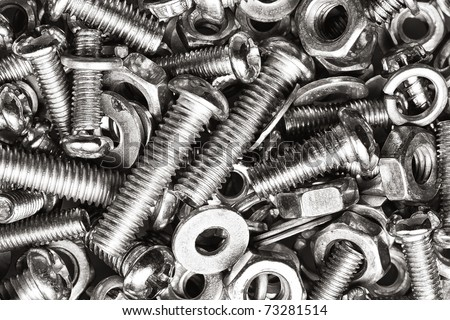 Macro shot of nut and bolts in black and white useful as a background - stock photo