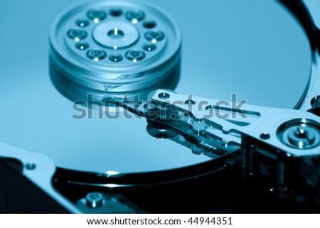 Macro shot of opened hard disk. - stock photo