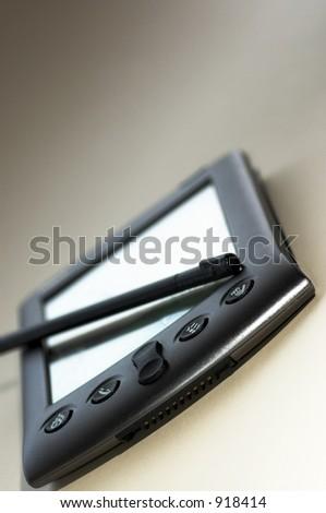 macro shot of palm Vx personal digital assistant - stock photo