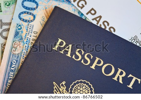 Macro shot of passport and foreign currency with boarding pass - stock photo