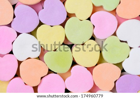 Macro shot of pastel candy hearts for Valentine's Day. The hearts are all bland and ready for your message. - stock photo