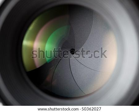 Macro shot of photographic lens. Focus on shutter - stock photo