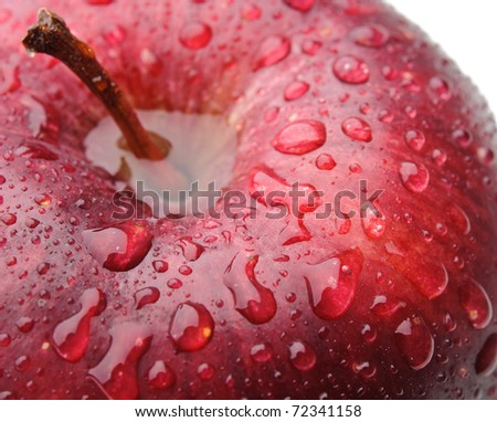 Macro shot of red apple with drops of water. - stock photo