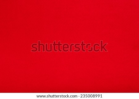 Macro shot of red felt tissue cloth, closeup texture background with details in structure. - stock photo