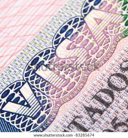 Macro shot of Schengen visa in passport - stock photo