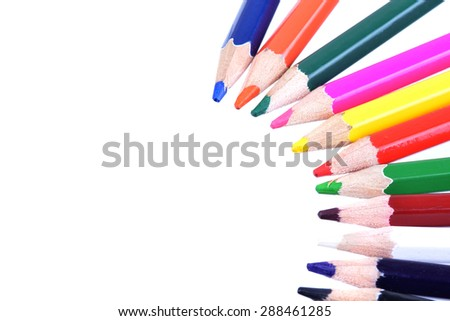 Macro shot of several color pencils on white - stock photo