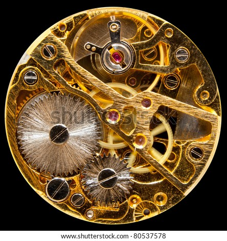 Macro shot of the interior of an old pocket watch with a hand-wound mechanical movement - stock photo