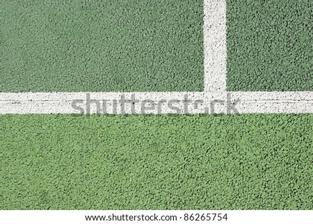 Macro shot of the lines of a tennis court in asphalt - stock photo