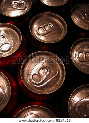 Macro shot of the tops of a bunch of aluminum cans. - stock photo