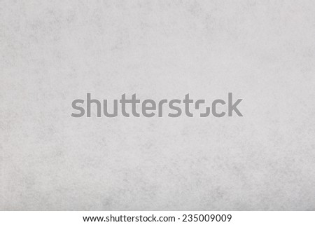 Macro shot of white felt tissue cloth, closeup texture background with details in structure. - stock photo