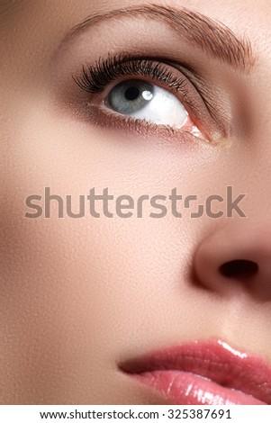 Macro shot of woman's beautiful eye with extremely long eyelashes. Sexy view, sensual look. Female eye with long eyelashes. Eyelashes extensions. Perfect make-up - stock photo