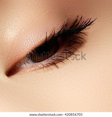 Macro shot of woman's beautiful eye with long eyelashes. Sexy view, sensual look. Female eye with long eyelashes - stock photo