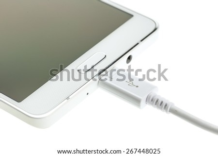 Macro Smartphone connect with charger isolated on white background - stock photo