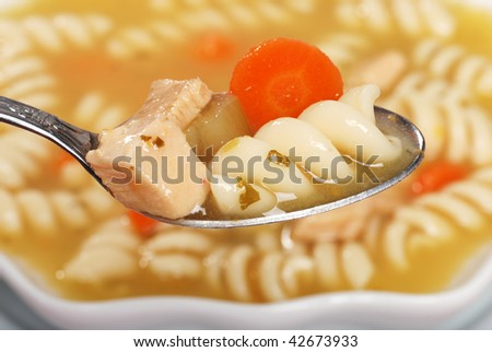Macro Spoonful Of Chicken Pasta Soup - stock photo