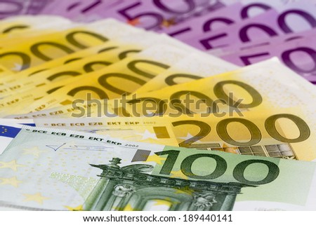 Macro stack of money with 100 200 and 500 euro banknotes. Perfect for illustrating e.g. wealth, lottery prizes or banking crises. What is your dream? - stock photo