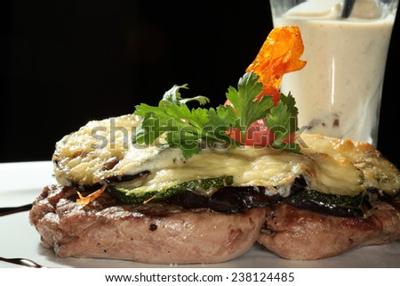 macro steak with baked vegetables and white sauce - stock photo