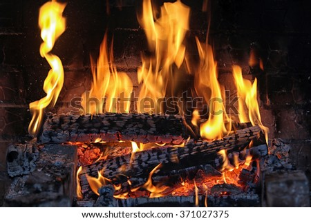 macro texture flame from the burning logs in the fireplace  - stock photo