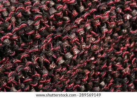 macro texture of burgundy knitted fabric studio - stock photo