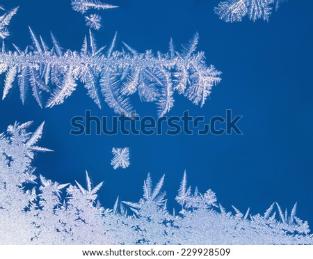 Macro texture of natural winter hoarfrost on window glass  - stock photo