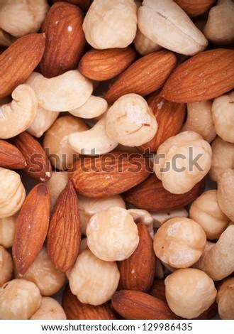 Macro texture of roasted mixed nuts - stock photo