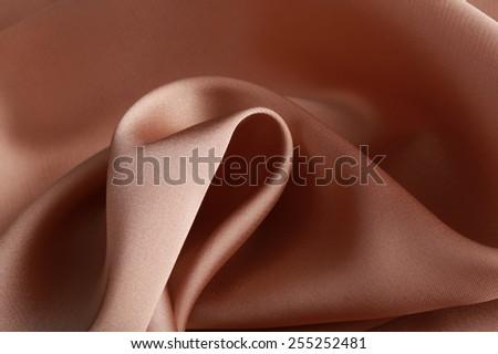 macro texture of satin fabric cream color studio - stock photo